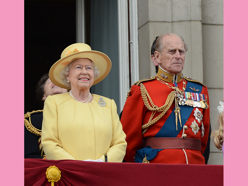 Why does the queen always wear bright colours?